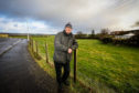 Local resident Jim Currie beside the field earmarked for development.