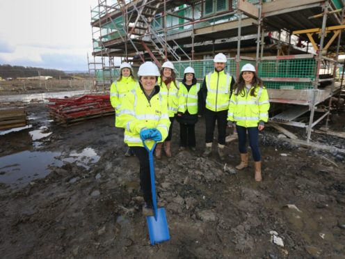 Fife Labour councillor Judy Hamilton marked the start of work to build new council houses in Inverkeithing. Judy Hamilton, front, with, from left, Debbie Ford of Fife Council, Pauline Mills of Taylor Wimpey, Helen Wilkie of Fife Council, and Kenny Gorman and Abby Kelman of Taylor Wimpey.
