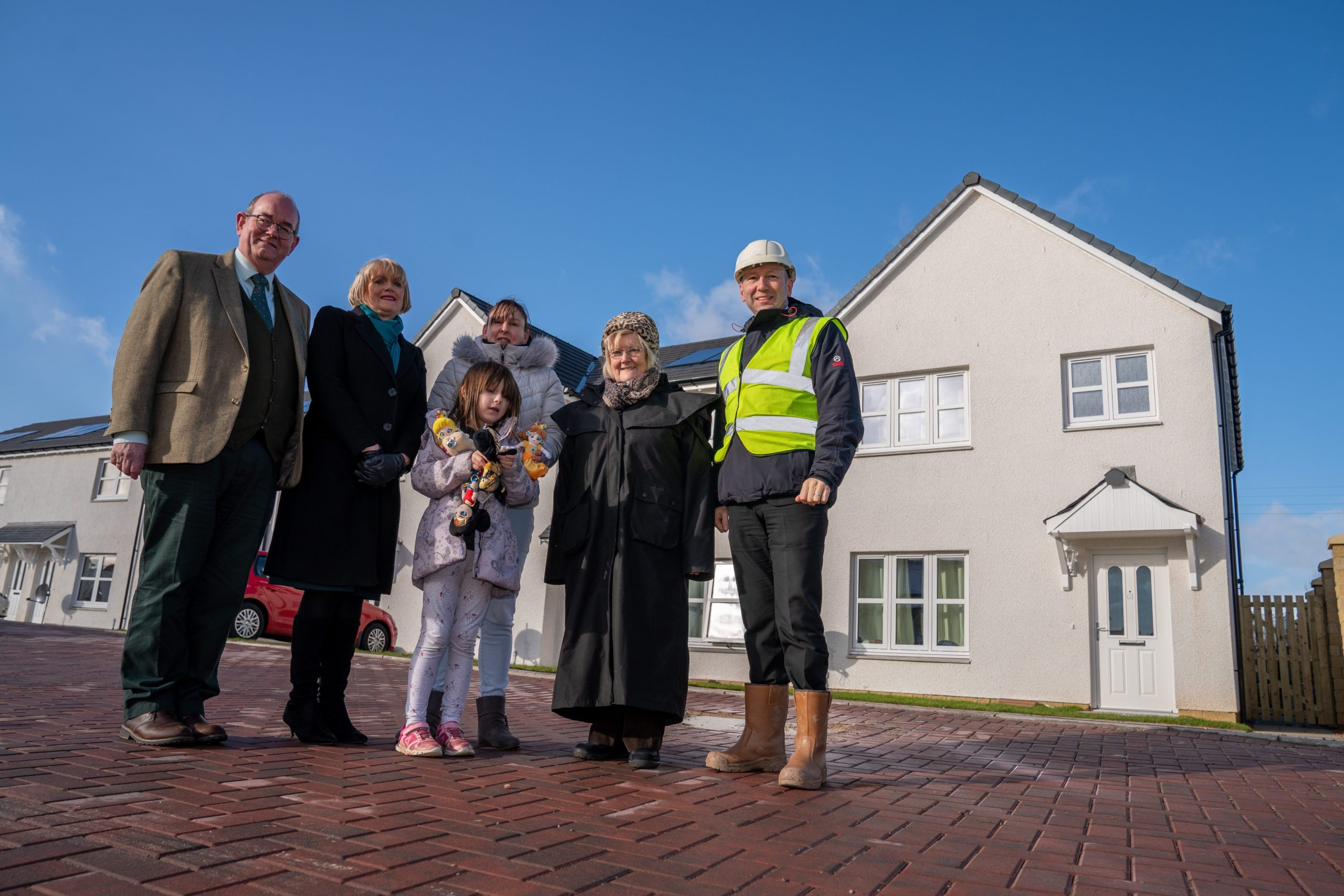 Councillor Bob Brawn, Alastair White (Managing Director Muir Homes), Local Tenant Veronica Robb and her 9 year old daughter Eve, Councillor Anne Jarvis and Barbara Renton. Picture: Kenny Smith.