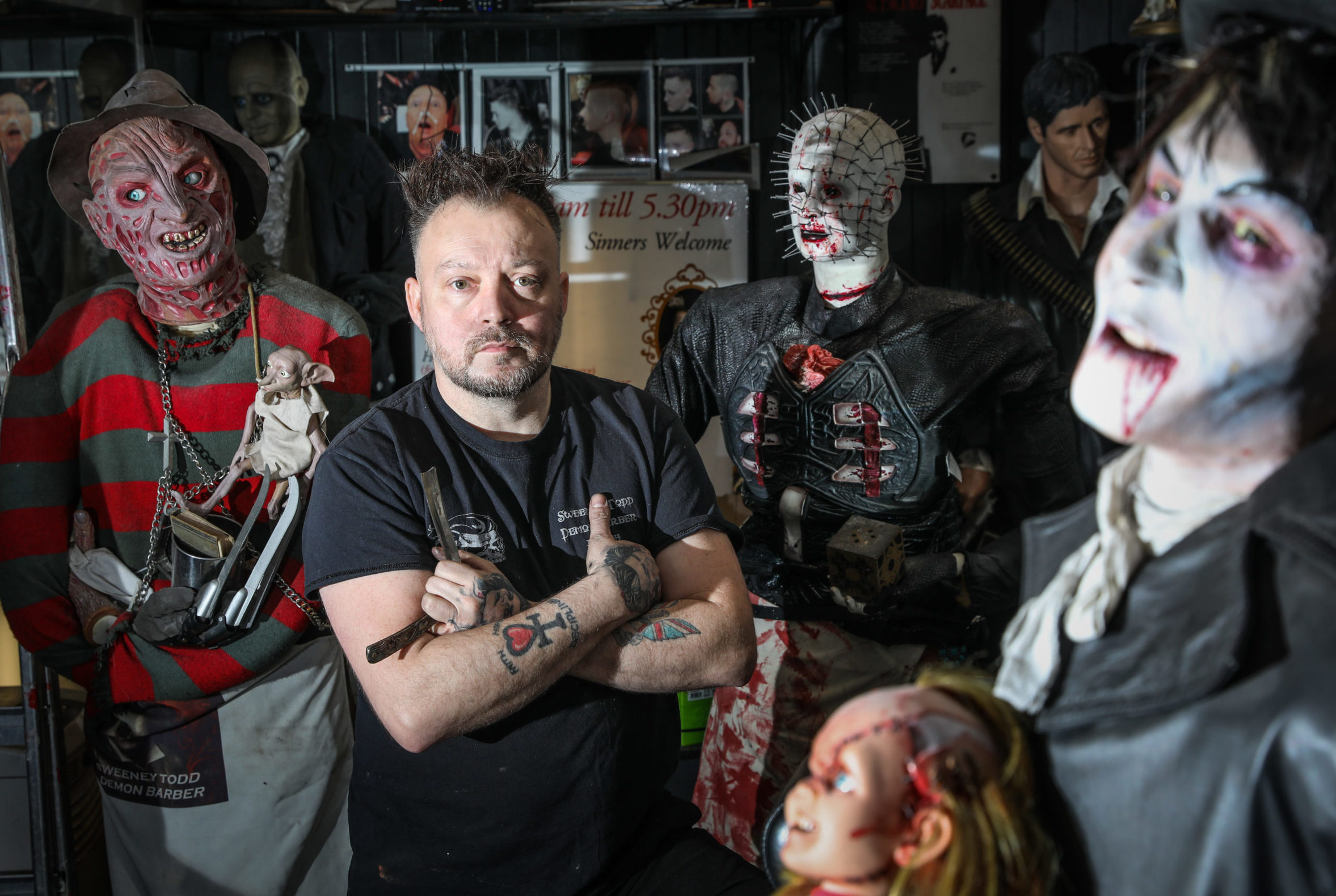 Owner Will Robertson in his Sweeney Todd barber shop with some of his collection.