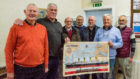 Allan Hay donor of the Titanic kit, middle, Billy Allan Chair, Stonehaven Men's Shed, right, Dave Ramsay, Mearns Heritage Services, along with Men's shed members who will be working on the project.