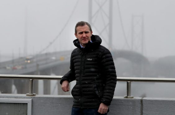 Transport Secretary Michael Matheson with the Forth Road Bridge in the background during a visit to the control centre at the Queensferry Crossing, South Queensferry.