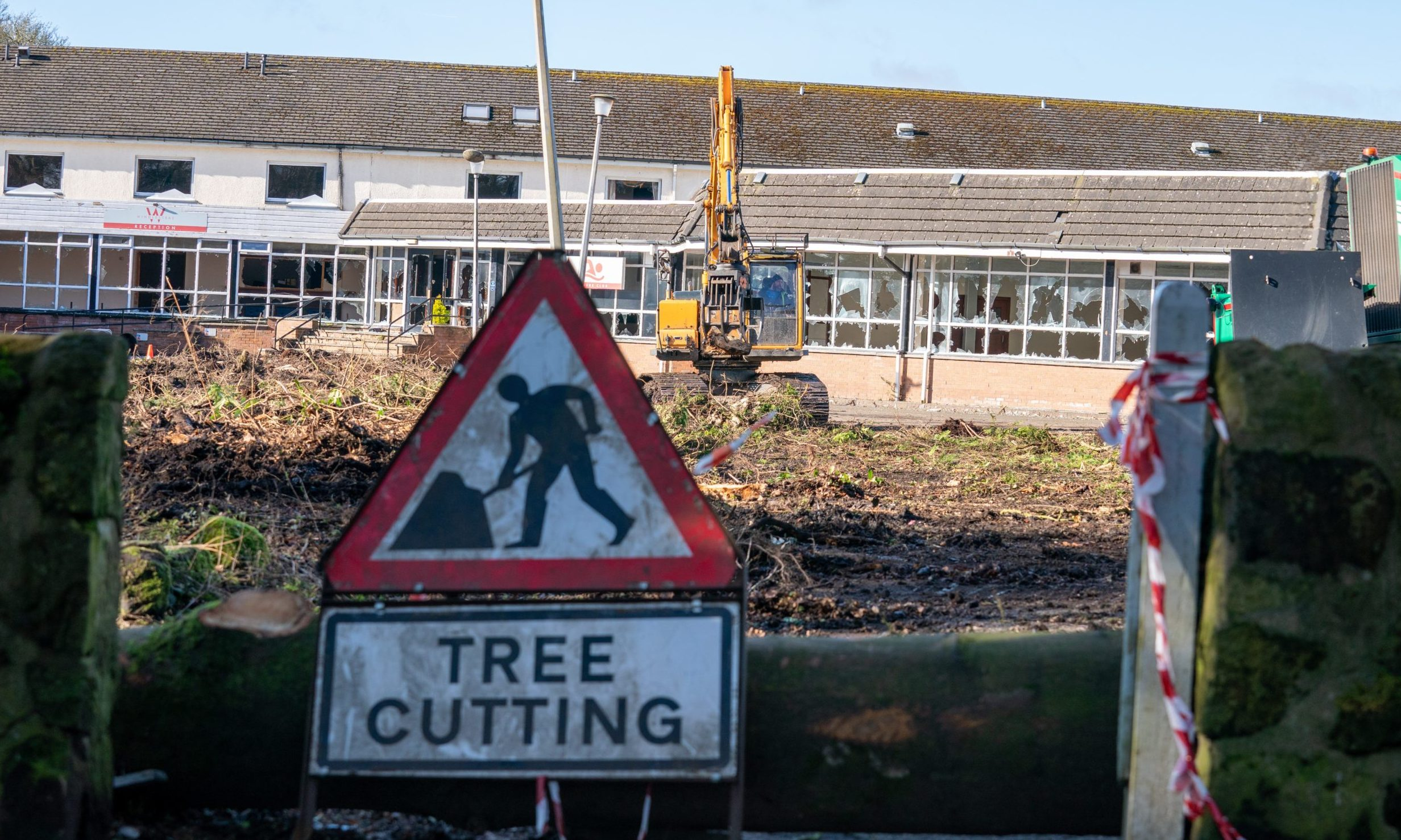 Trees ripped from ground as demolition begins on the Windlestrae hotel
