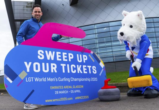 British Curling National Coach David Murdoch and Sweep the mascot at the Emirates Arena.