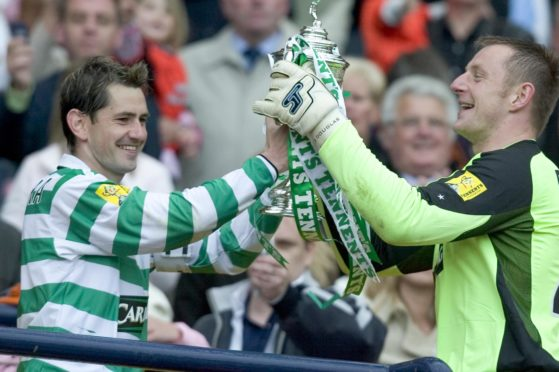 Jackie McNamara celebrates a cup triumph with Rab.
