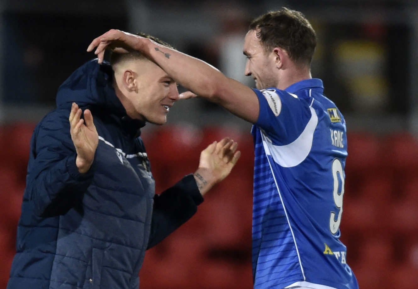 The two goalscorers against Motherwell celebrate at full-time.