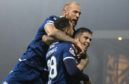 Declan McDaid celebrates a goal with Kane Hemmings.