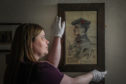 Museum Assistant Fiona Connah, with a portrait of David Buchan.