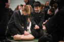 Perth High School pupils, Cameron Craik, 14 and Myles Woodside, 12, doing CPR training.
