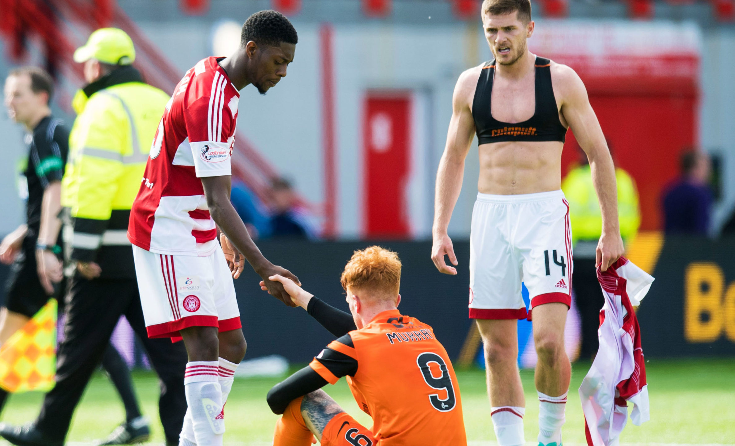 Rakish Bingham consoles Simon Murray after Hamilton beat Dundee United in the play-offs.