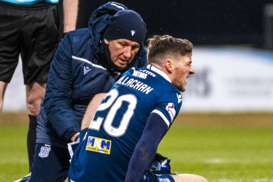 DUNDEE, SCOTLAND - FEBRUARY 08: Dundee's Ross Callachan goes down injured during the Ladbrokes Championship match between Dundee and Partick Thistle at the Kilmac Stadium at Dens Park on February 08, 2020 in Dundee, Scotland. (Photo by Euan Cherry / SNS Group)