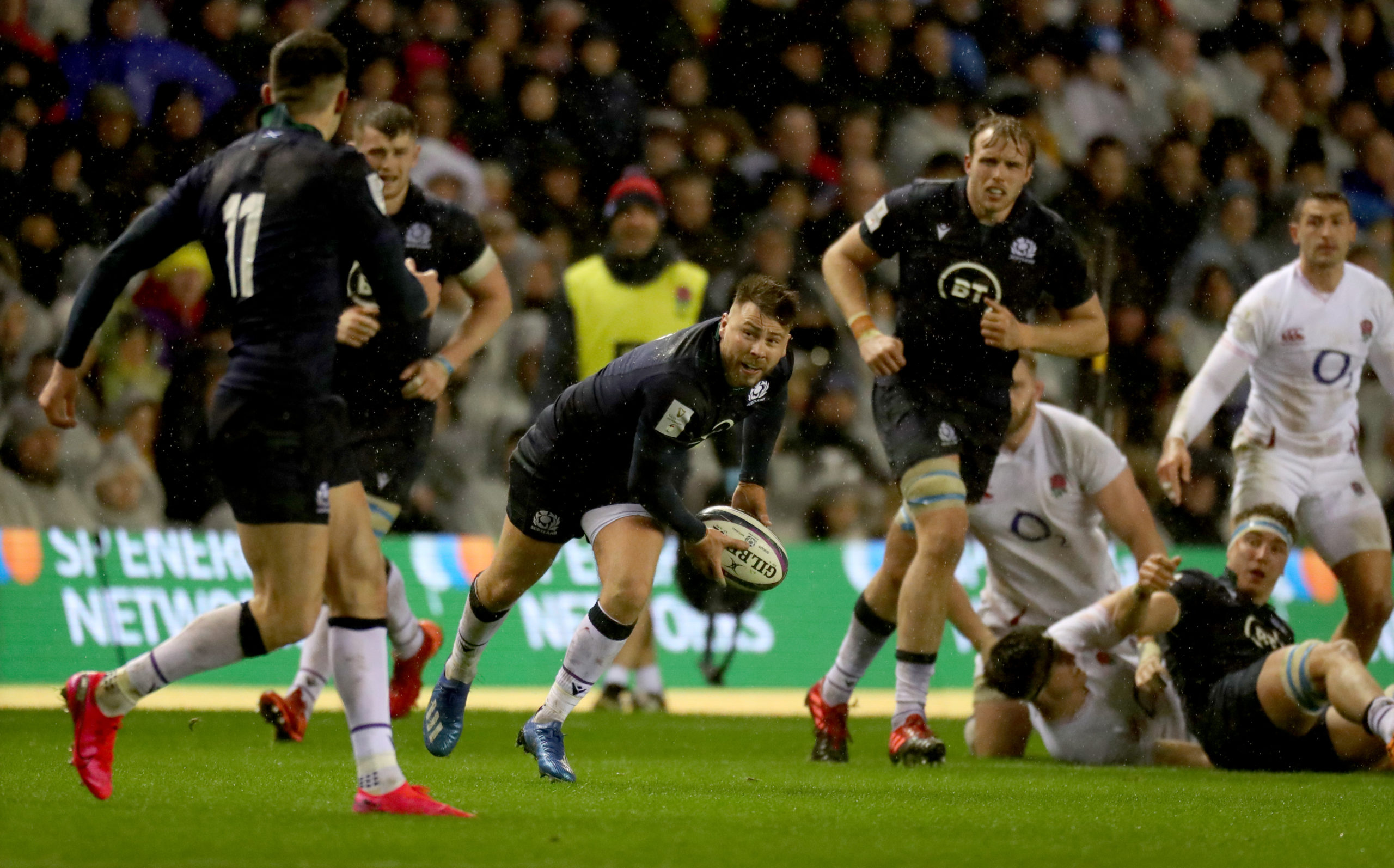Ali Price tries to launch a Scotland attack against England.