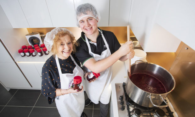 Owen Foster, from Forfar, Angus making jam with his grandma Joyce.