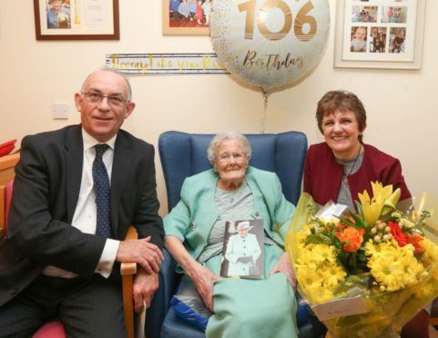 Betty Craig on her 106th birthday with Colonel Jim Kinloch and Councillor Judy Hamilton.