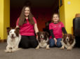 Sisters Sophia(13)(left) and Jessica Herald are to compete with their dogs in the young kennel club flyball at Crufts Their three dogs from the same litter called Yoda, Eclipse and Whim.
