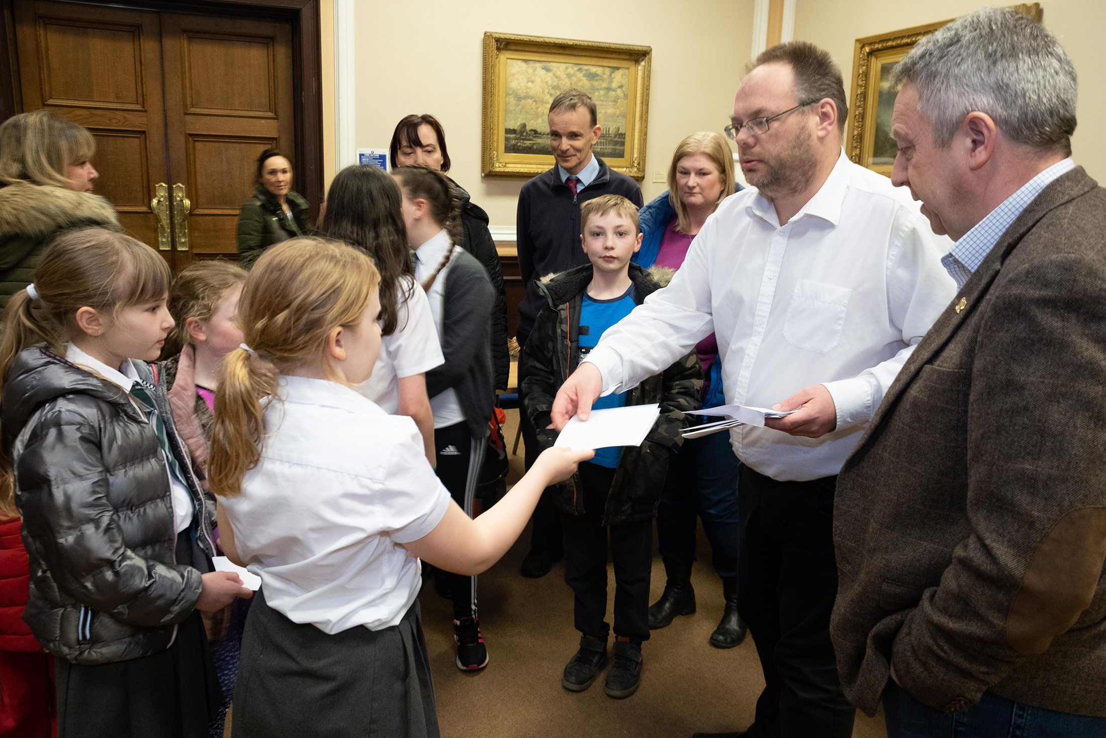 Children handing over their letters to Stewart Hunter, education convener at Dundee City Council