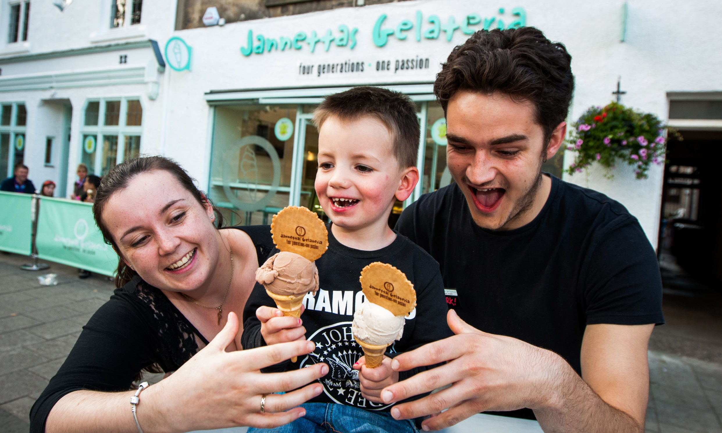 Luke Latto enjoying two ice creams with Beth McConnochie and Mark Edwards at Jannettas Gelateria.