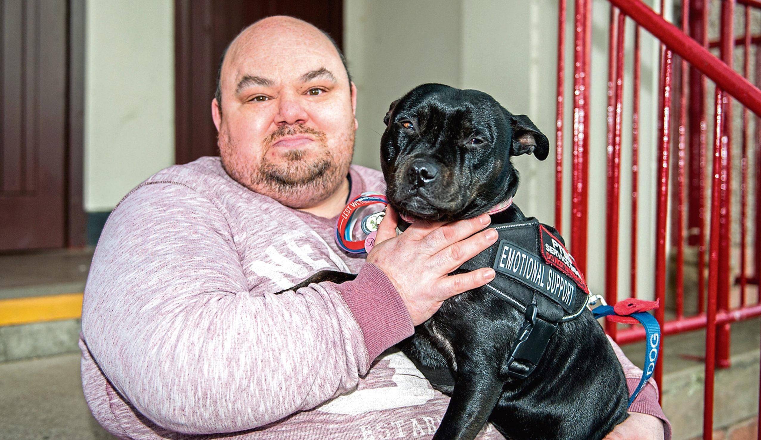 John Johnson and his support dog Poppy.