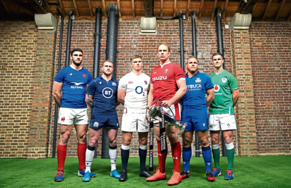 Team captains pose for a photo with the Six Nations Trophy (left to right) France's Charles Ollivon, Scotland's Stuart Hogg, England's Owen Farrell,  Wales' Alun Wyn Jones, Italy's Luca Bigi and Ireland's Jonathan Sexton during the Guinness Six Nations launch at Tobacco Dock, London. PA Photo. Picture date: Wednesday January 22, 2020. See PA story RUGBYU Six Nations. Photo credit should read: Steven Paston/PA Wire. RESTRICTIONS: Editorial use only. No commercial use.