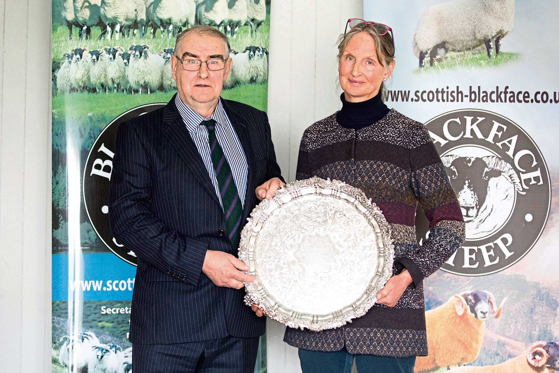 William Dunlop gets the Connachan Salver from Mary McCall Smith for his ''work ethic and integrity''.
