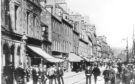 High Street, Perth, in days gone by.  High Street, Perth, looking east.  H313 19XX-00-00 High Street, Perth (C) DCT