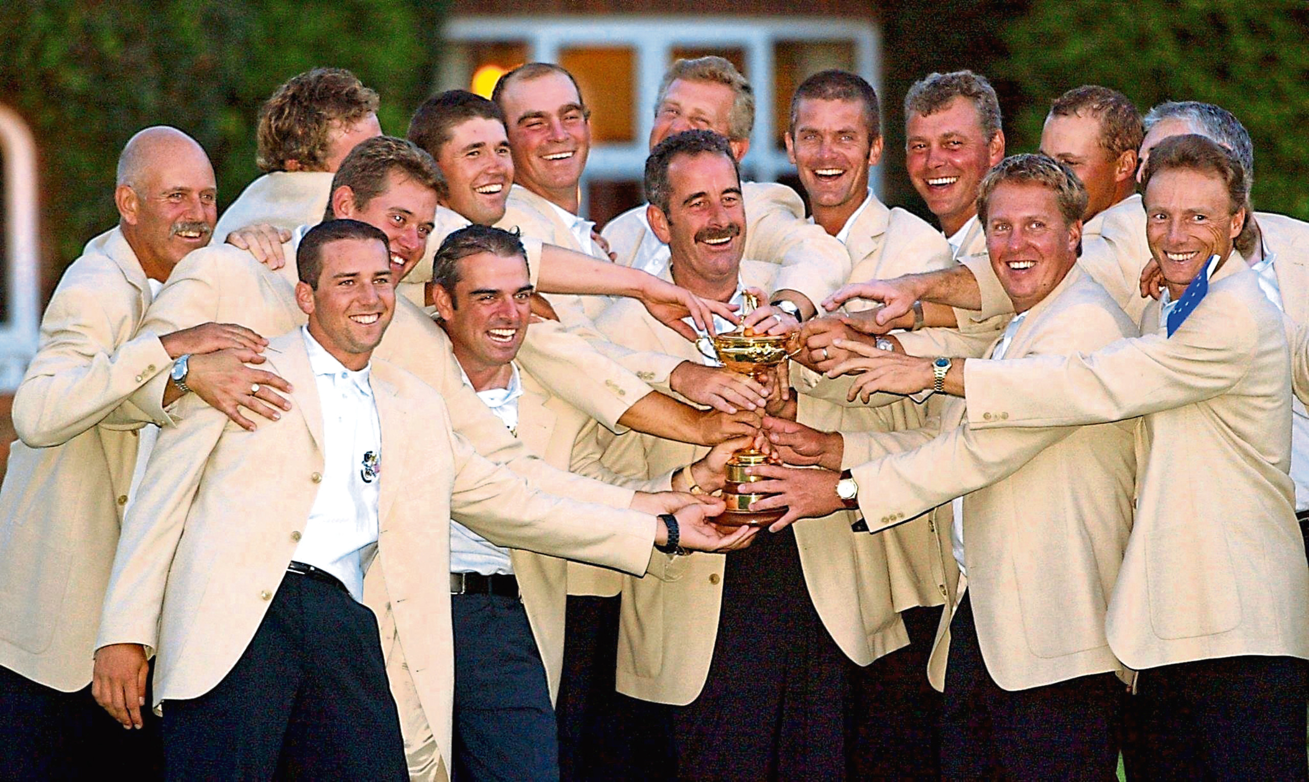 Mandatory Credit: Photo by Adrian Dennis/EPA/Shutterstock (7650925bk) Sutton Coldfield United Kingdom : European Team Captain Sam Torrance (c) Hold the Ryder Cup As His Team Surrounds Him After They Won the 34th Ryder Cup 29 September 2002 on the Brabazon Course at the Belfry in Sutton Coldfield England the Europeans Won the Ryder Cup15 1/2 To12 1/2 VARIOUS - Sep 2002