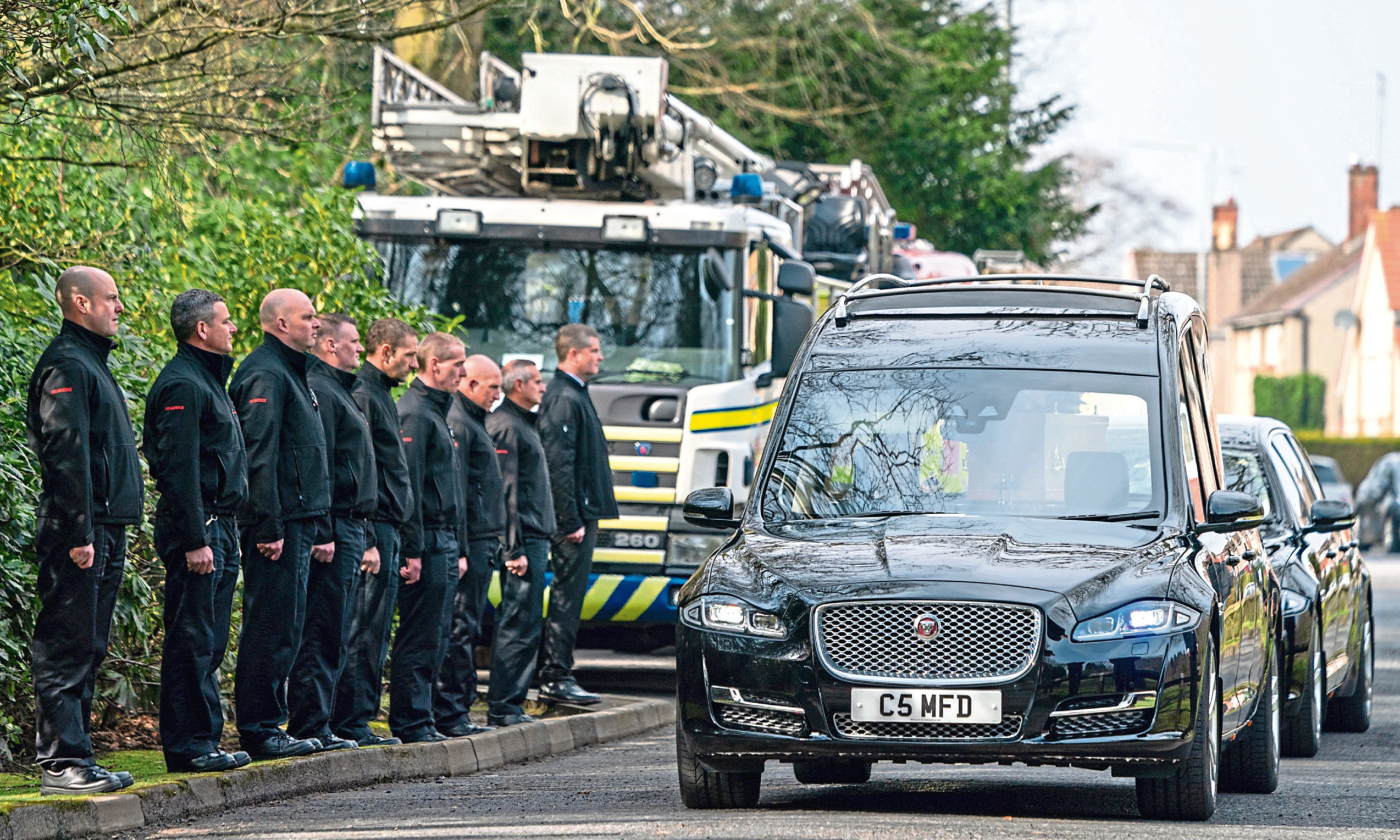 A guard of honour at the funeral of former firefighter Ian Wishart from Kirkcaldy.