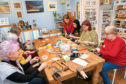 The beach glass pendant workshop in action - before the coronavirus outbreak.