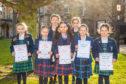 Class 422 competitors - prepared reading aged 7 or 8 - - front row, left to right, Olivia Gordon (Kilgraston School), Molly Hanton (St Leonards School, St Andrews), Paula Timmins (joint 3rd place, St Leonards School, St Andrews), Orla Blues (1st place, Craigclowan School), Elsie Stewart (2nd place, Kilgraston School). Back row, left is Alice Hutcheson (Kilgraston School) and right is Emma Horne (3rd place, Kilgraston School).
