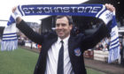 St Johnstone manager Alex Totten celebrates winning the first division in 1990.