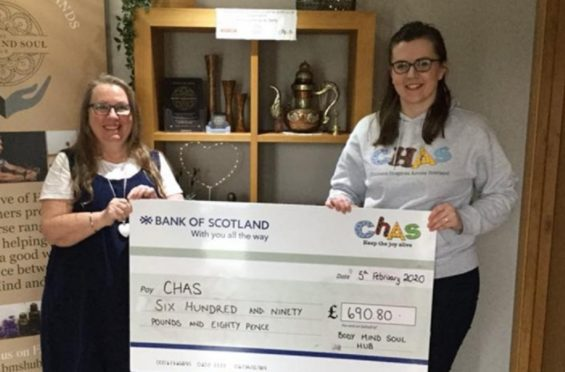 Morna Milton-Webber presents the charity cheque to CHAS community fundraiser Emma Moore.