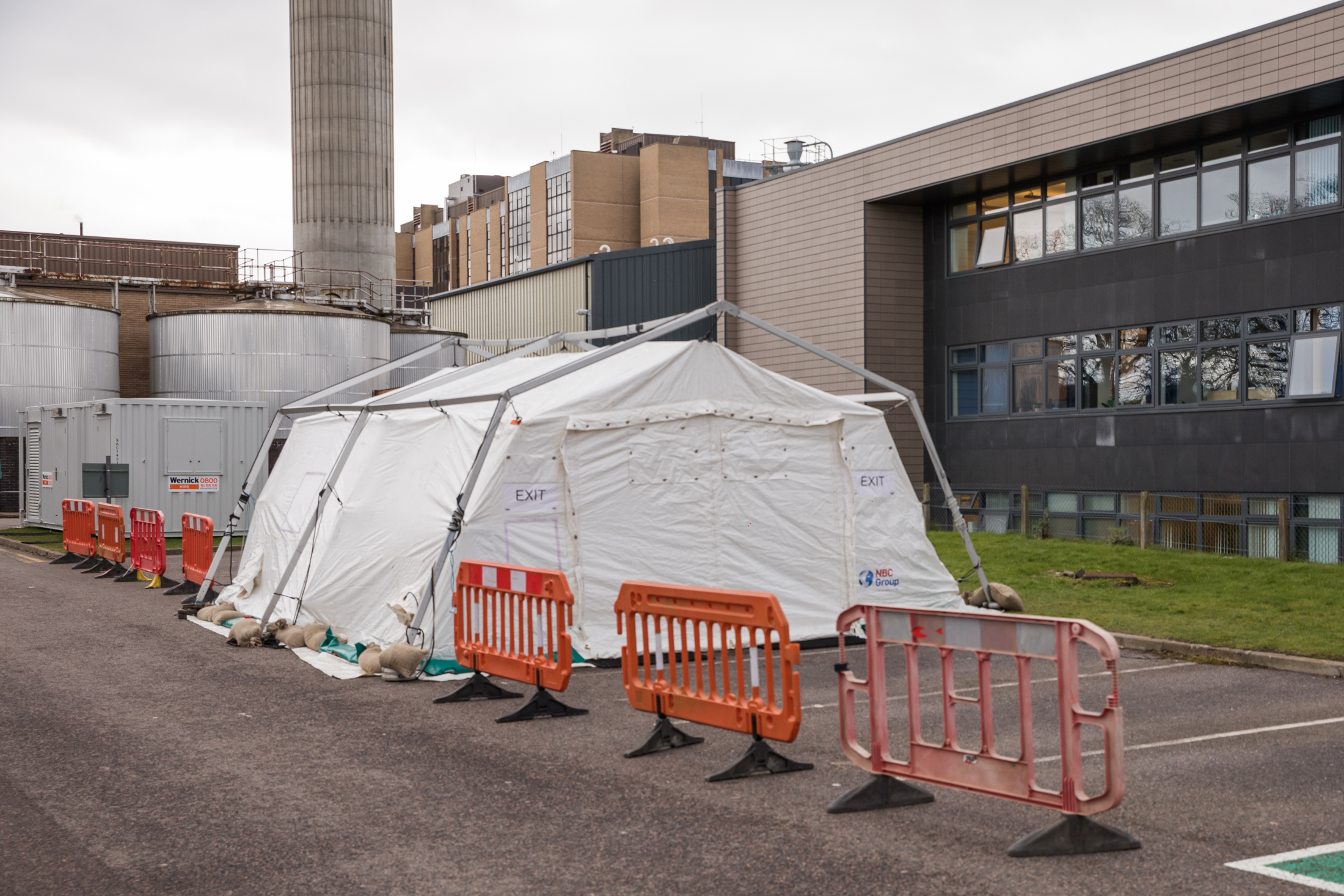 A tent erected behind Raigmore Hospital in Inverness is believed to be intended to screen people for coronavirus using a 'drive-through' setup.