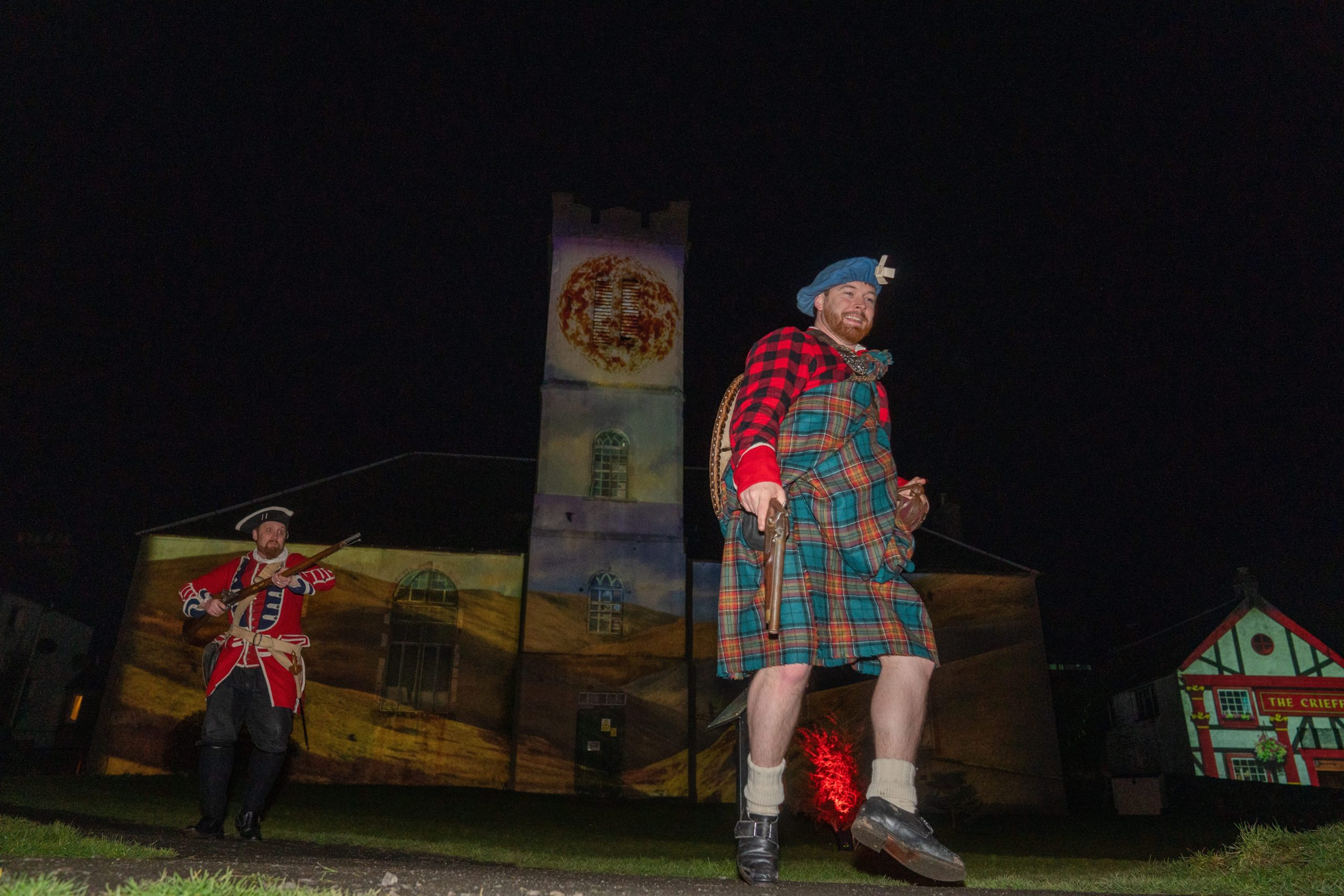 Rob Roy McGregor ( Nick Inees) is chased by a Red Coat (Daryll Wrighy) during the Fire & Folklore, Heroes & Villains festival