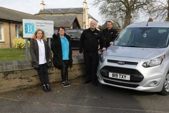 Joan Clements (senior carer) and Audrey Cant (care assistant) with Frank Brand and John McKenzie from Links Cabs, who are supplying free rides.