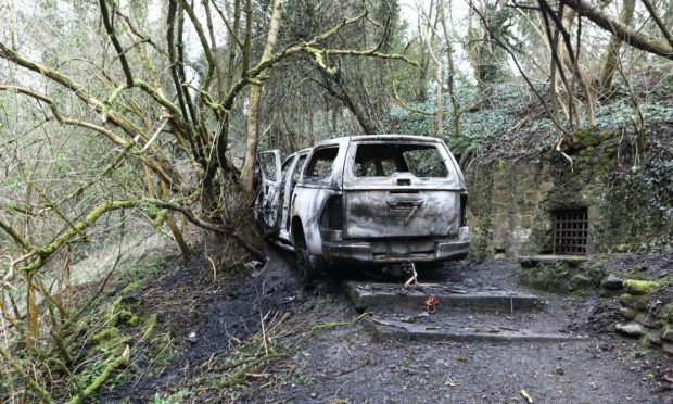 The burnt out car in Kennoway Den, Fife.