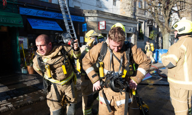 Firefighters at the scene of the blaze on South Street, St Andrews.