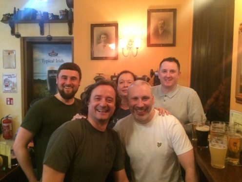 Michael Schroder, front left, with the Dundee stag do travellers, and Michael's wife Andrea at the back.