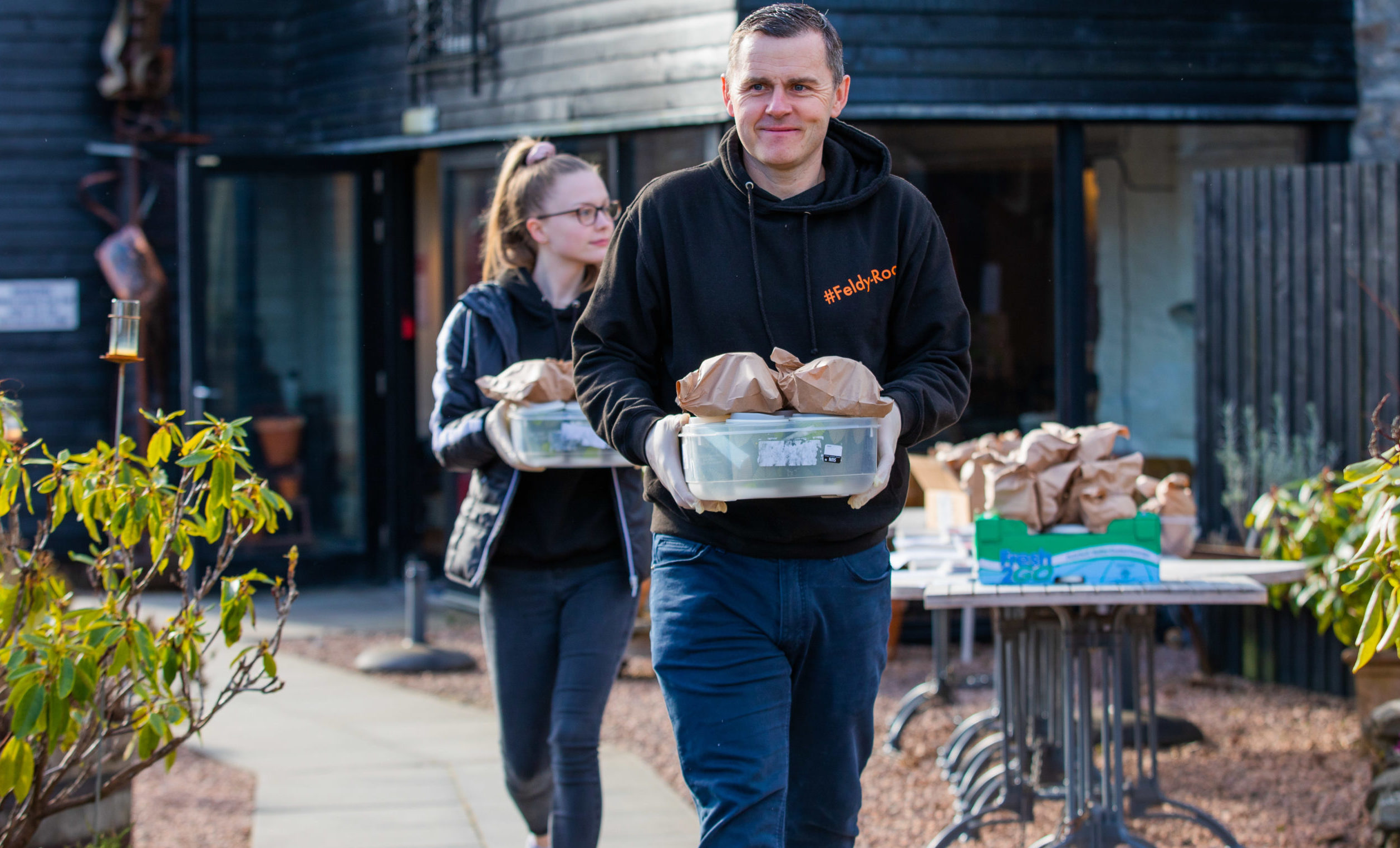 Hot food delivery 'Feldy-Roo' in association with Gavin Price. -- people arrive to collect food and papers to deliver for the morning run. Picture shows Ross Menzies and daughter Sasha Menzies. Watermill Gallery, Mill Street, Aberfeldy.