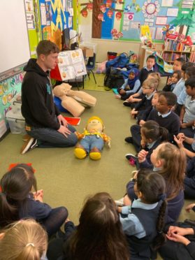 Sean Duffy, from First Stop Safety Training, teaching school children first aid.
