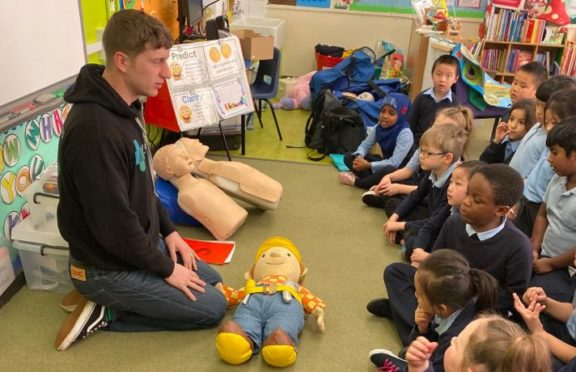 Sean from First Stop Safety Training teaching school children first aid.