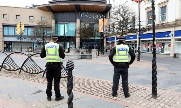 Police patrolling a deserted Dundee City Square.
