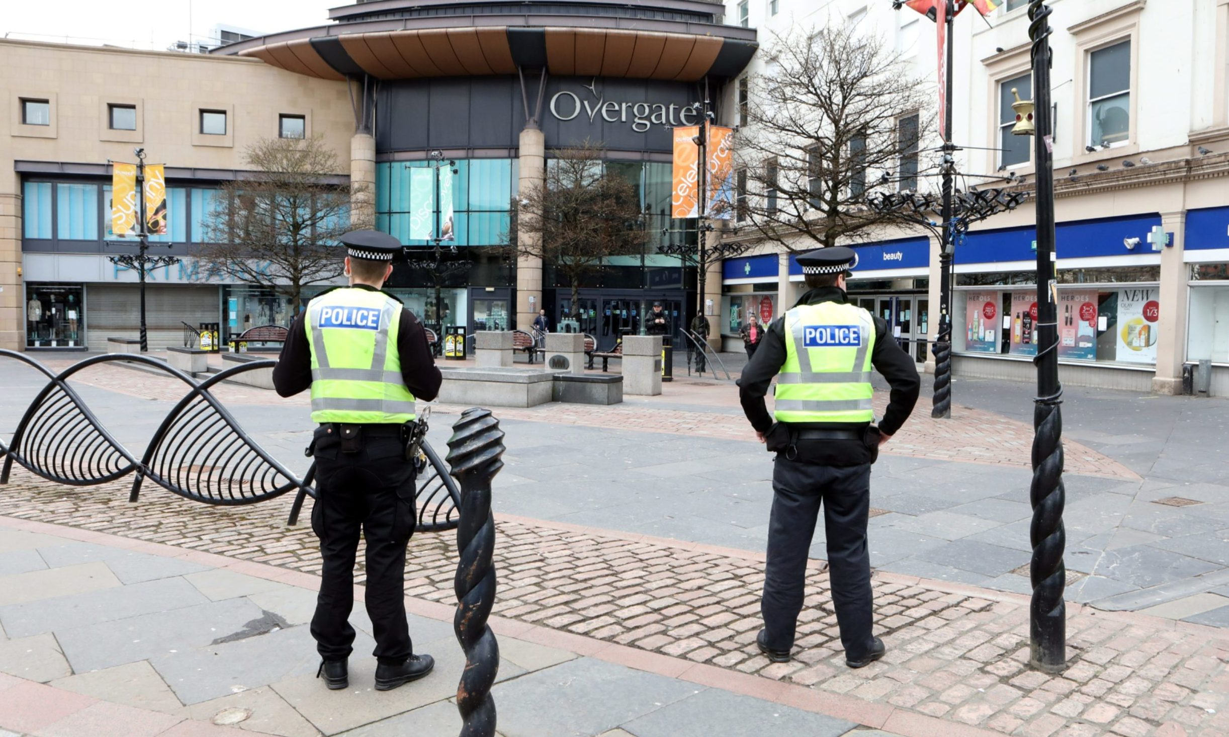 Police patrolling a deserted Dundee City Square during the initial lockdown.