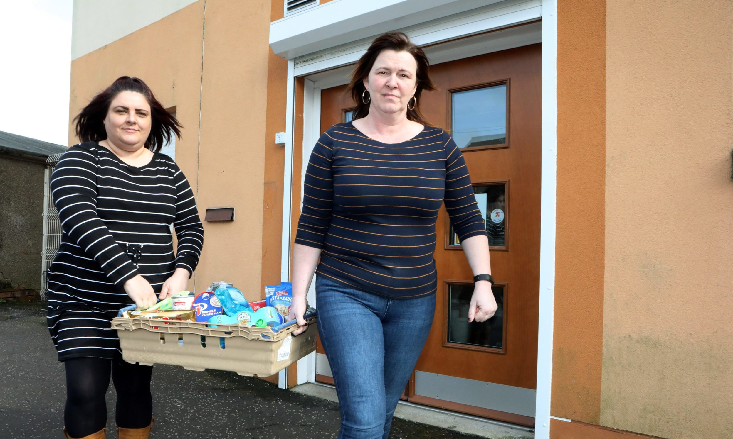 Pauline Buchan & Lana Moffat helping the self-isolated in Kirkcaldy on Tuesday.