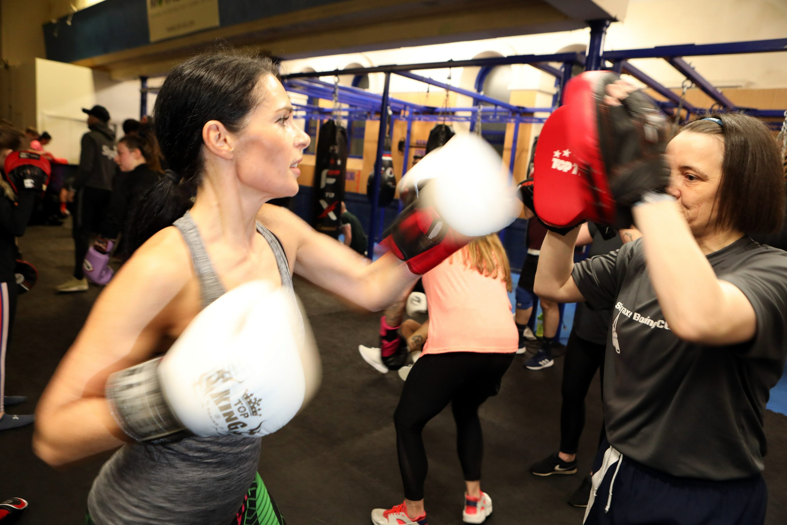 Gayle sparring with coach Niki Bain at Skyaxe Boxing Gym.