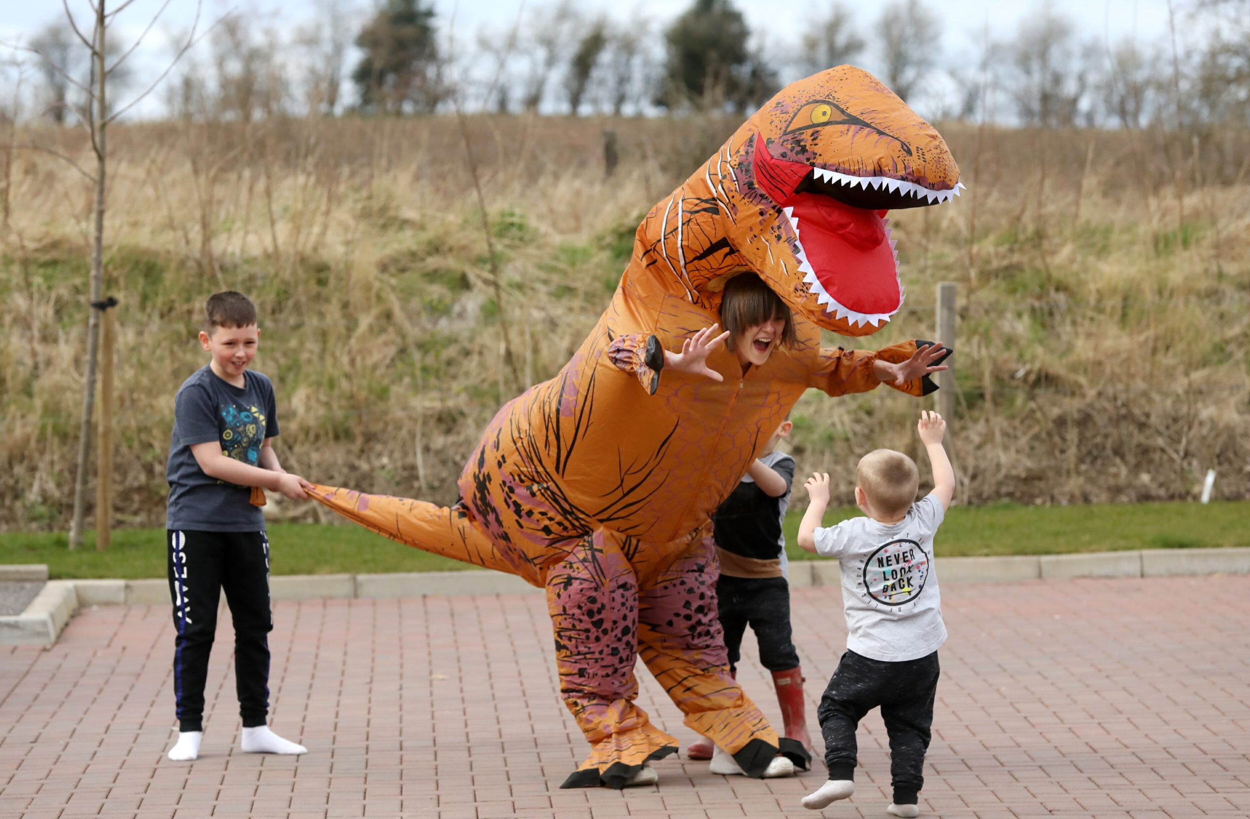 Yasmin Elder (28) is dressing as a dinosaur and walking the streets tomorrow to cheers up the kids during the lockdown.   Pictured with her kids Odin(4), Theon (2) and Gabriel (9).