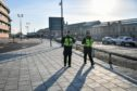 British Transport Police patrol the perimeter of Bristol Temple Meads train station, which is empty of rush-hour commuters and travelers at 8am the day after Prime Minister Boris Johnson put the UK in lockdown to help curb the spread of the coronavirus.