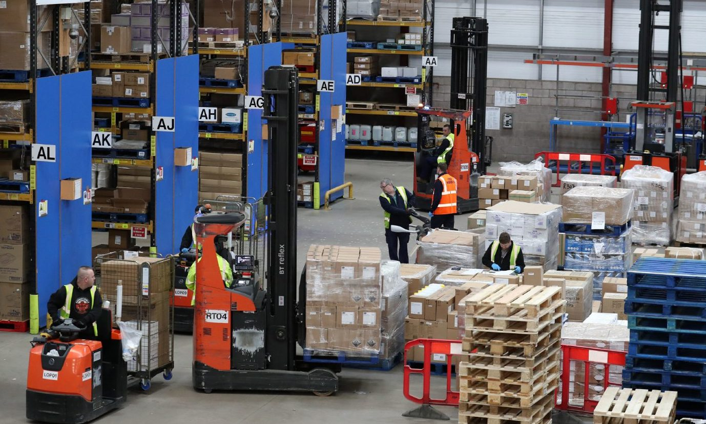Workers gather supplies at the NHS' National Procurement Warehouse at Canderside, Larkhall, as deliveries of personal protective equipment (PPE) increased.