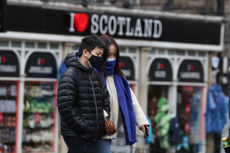 People wearing face masks in Edinburgh.