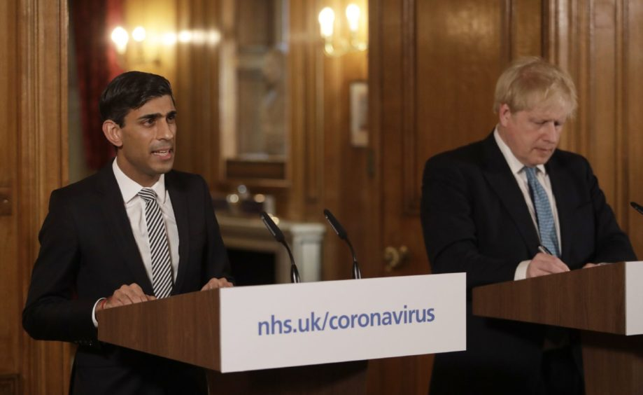 Chancellor Rishi Sunak with Prime Minister Boris Johnson at a media briefing in Downing Street.