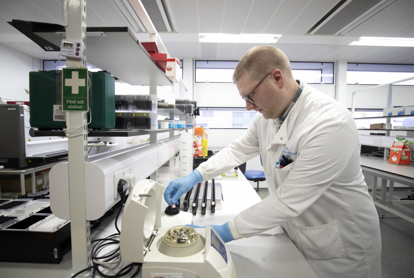 Clinical support technician Douglas Condie extracts viruses from swab samples so that the genetic structure of a virus can be analysed and identified in the coronavirus testing laboratory.
